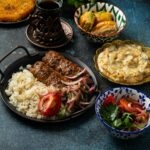 Traditional Turkish food, assorted dishes and mezze appetizers on rustic background